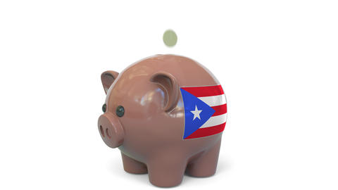 Putting money into piggy bank with flag of Puerto Rico. Tax system system or Live Action