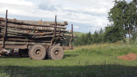 Machine loaded with long logs. Winter heating concept Footage