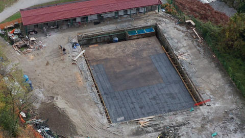 Public bath, swimming pool construction site with contractor workers on the Footage