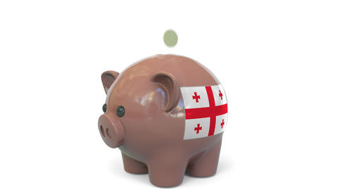 Putting money into piggy bank with flag of Georgia. Tax system system or savings Live Action