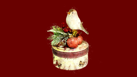 Watercolor Christmas tree decoration - bird on a gift box, on the alpha channel GIF