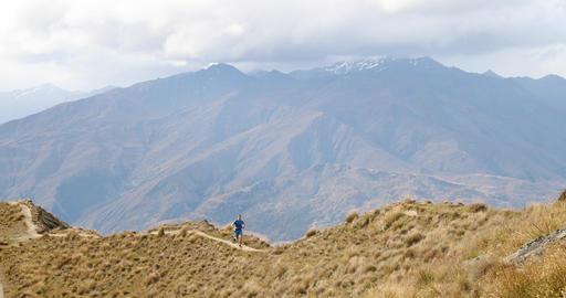 Running man athlete on trail run in mountains Footage