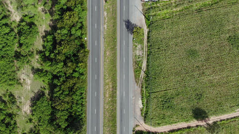 Aerial view scenic landscape of countryside highway traffic with a car and truck on the road, Drone Live Action