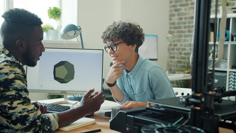 Creative designers discussing 3d printing in office using modern equipment Footage