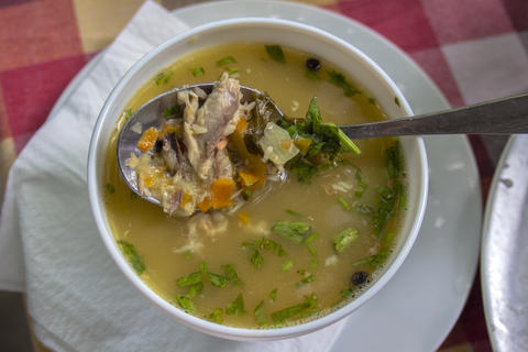 Closeup of a serving of veal soup with vegetables Photo