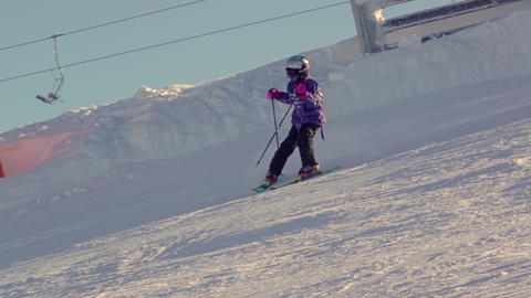 Dad Teaches a Child to Ski Down. Slow Motion Footage
