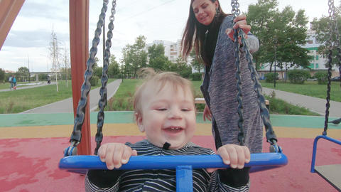 Baby boy on a swing Footage