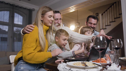 Charming family of adults and children sitting at the table and saying goodbay Footage