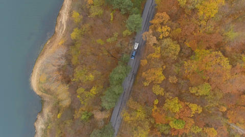 Drone chasing suv or car twoing a white boat, driving along asphalt road near Live Action