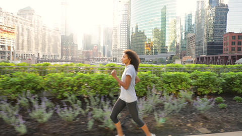 Attractive African American woman on her morning jog along the Chicago River GIF