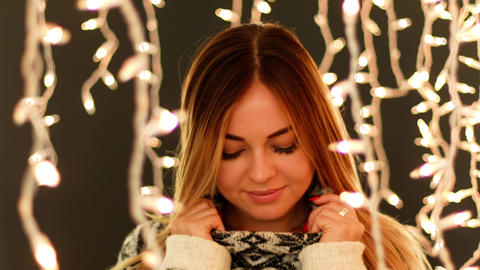 Cute Women in Front of Christmas Lights GIF