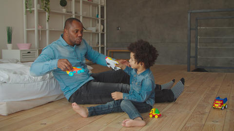 Multiethnic family with kid enjoying playtime at home Archivo