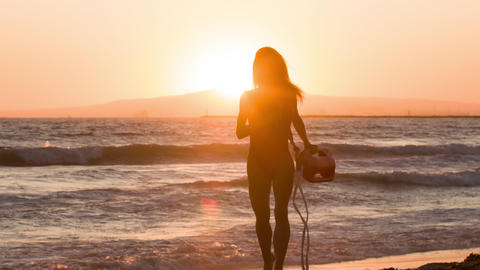 Female lifeguard running along the beach Archivo