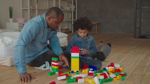Positive diverse family enjoynig playtime at home Footage