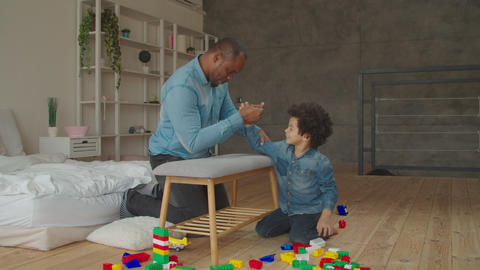 Black father and son competing in arm wrestling Live Action