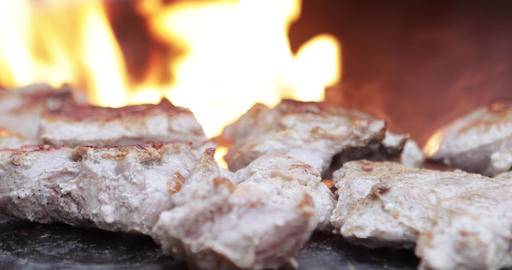 Cooking meat in grill bbq ビデオ