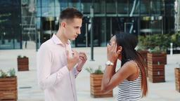 Beautiful black woman accusing her husband of treason outdoors Footage
