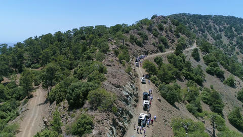 Flying Over Group of Jeeps in Green Mountains Archivo