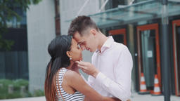 Sensitive portrait of two multiracial lovers touching foreheads outdoors GIF