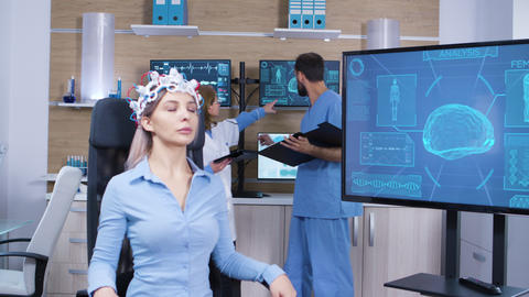 Female patient falling asleep while wearing brain activity scanner Footage