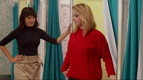 Friends in the fitting room, one girl tries on a sweater Footage