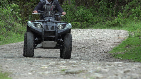 Man Driving ATV on Dirt Road Footage