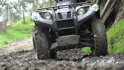 Man Driving ATV Through Mud Footage