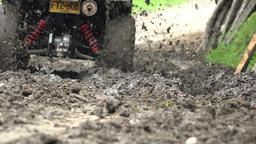 Driving ATV Through Mud Footage
