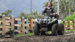 Man Driving ATV on Dirt Road Live Action