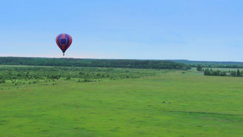 Hot air balloons smooth aerial view pov. Flying over suburb, neighborhood Footage