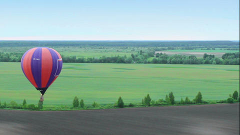 Blue horizon aerial shot from hot air balloon pov. Flying over suburb, fields Footage