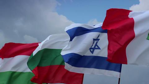 Israeli, French, Bulgarian, Hungarian flags. Peaceful meeting, European states Footage