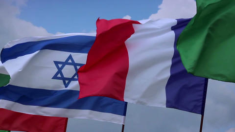 French, Israeli flags on flagstaff. France, Israel negotiations. Wind waving Footage