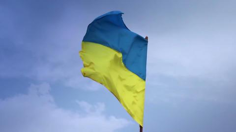 Ukrainian national flag waving on flagpole in blue sky. Ukraine Footage