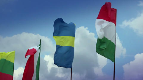 Various flags on flagpoles: Sweden, Hungarian, Italian, Romanian. Sweden, Italy Footage