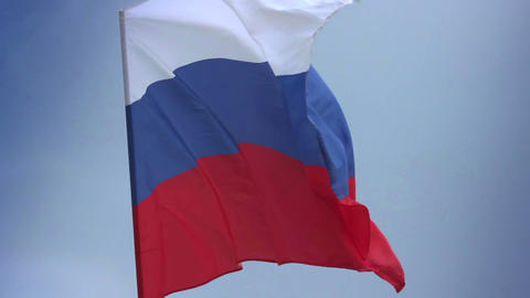 Russian national flag waving on flagpole in blue sky. Russia Footage