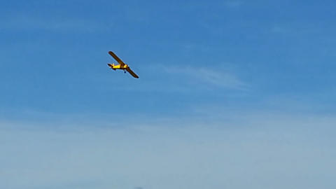 Yellow vintage airplane flight, sunny day blue sky bright colors Footage