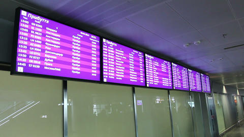 Information screens at airport lobby. Flight arrivals and departures screen Footage