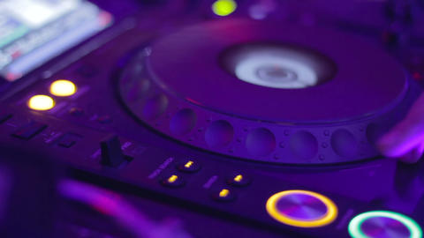 DJ CD turntable blinks until female hand turns it off Footage