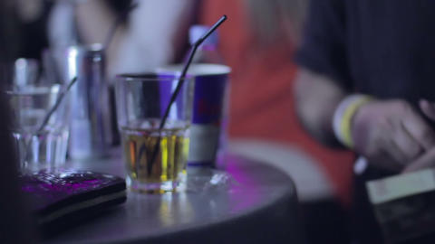 Bar visitor prepares money to pay drinks, but can't find enough to pay alcohol Footage