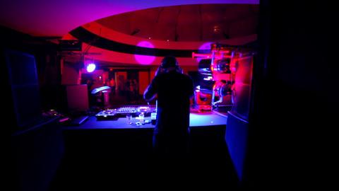 DJ plays for empty room. DJ sound check Live Action