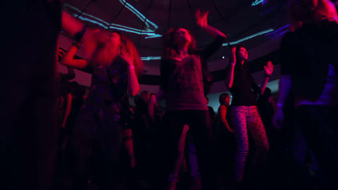 Low angle shot of dancing audience in night club Footage