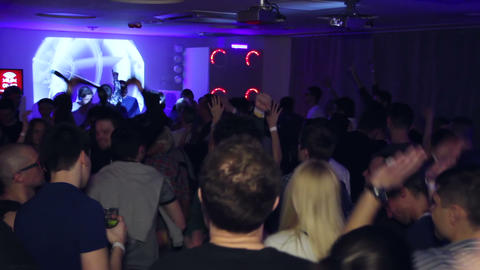Men and women dance at discotheque clapping hands Live Action
