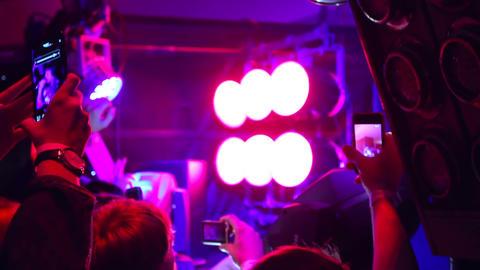 People in crowd shooting DJ using their phones in night club Footage