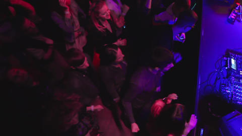 Top view slow motion dancing people shot in night club under strobe club lights Live Action