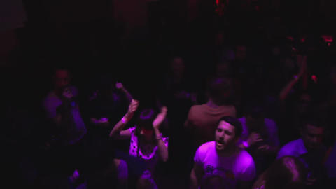Strobe light in night club during discotheque party indoors, people dancing Live Action