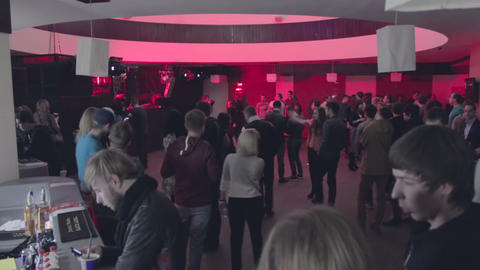 Timelapse of filling dance floor. People come, get drinks, dance, leave Footage