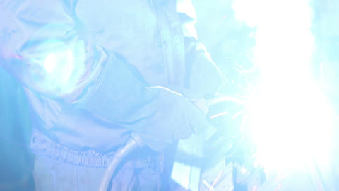Welding operator welds with torch at welding-site Footage