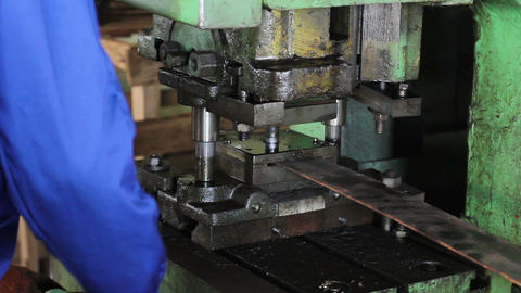 Factory repetitive moves, male stamping holes in iron…, Live Action