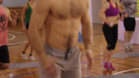 People run in gym, male's muscular torso. Man jogging, fitness gymnastics Footage
